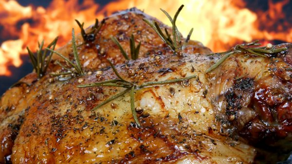 Traditional English wine marinade roast by romantic fire, conceptual sunday or xmas lunch macro close up